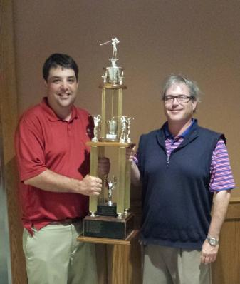 Peter Morgante and Jon Gren Jr. are pictured with the trophy after winning the Italian-American Charity Golf Tournament on Saturday. Submitted photo
