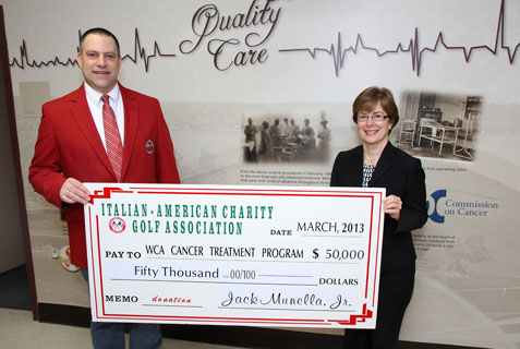 Jack Munella Jr., chair of the Italian American Charity Golf Association, presents a check in the amount of $50,000 to Betsy Wright, WCA Hospital president/CEO, representing the proceeds from 2012 Italian American and the final installment of a three-year, $150,000 pledge for the purchase of Electromagnetic Navigation Bronchoscopy to aid in the diagnosis and treatment of lung cancer at WCA.