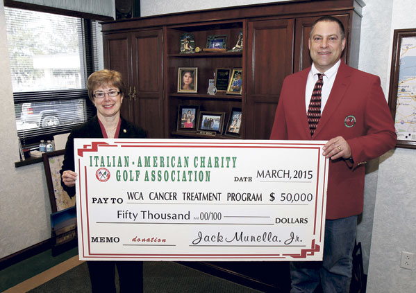 Jack Munella, Jr., chair of the Italian American Charity Golf Association, presents a check in the amount of $50,000 to Betsy Wright, WCA Hospital president/CEO, representing the proceeds from the Italian American's 2014 fundraising activities and the second installment of a three-year, $150,000 pledge to enhance local cancer care at WCA Hospital through the purchase of a Fluoroscopic C-Arm.