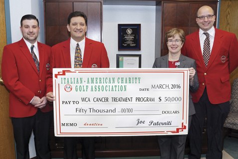 Members of the Italian American Charity Golf Association present a check in the amount of $50,000 to Betsy Wright, WCA Hospital president/CEO representing the proceeds from the Italian American's 2015 fundraising activities and the first installment of a three-year, $150,000 pledge to enhance local cancer care at WCA Hospital through the purchase of the Carestream DRX-Ascend. From left: Dave Foti, committee member of the Italian American Charity Golf Association, Joe Paterniti, chair of the Italian American Charity Golf Association; Betsy Wright, WCA Hospital president/CEO; and Joe Calimeri, committee member of the Italian American Charity Golf Association. Submitted photo